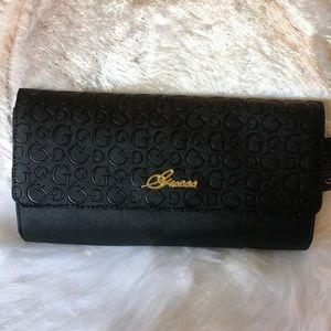 Clutch handbag by Guess
